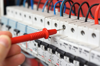 Electrician Servicing Electrical Switchgear